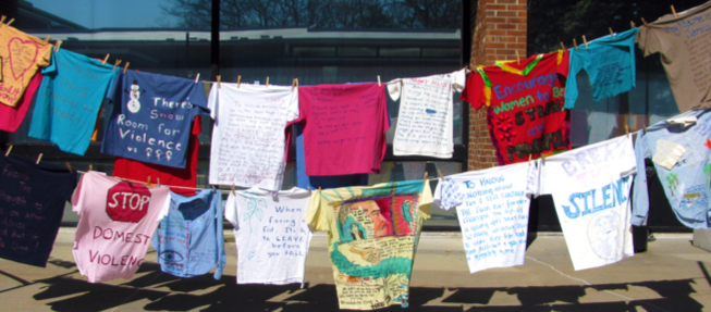 Image of t-shirts hung on a line for the Clothesline Project