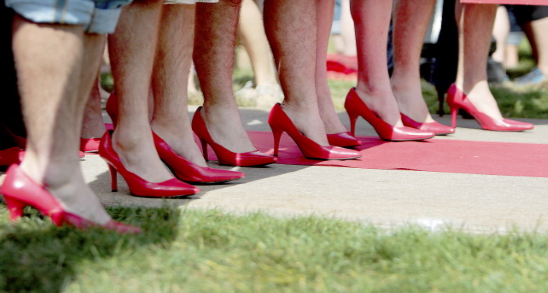 Image of men in red high heels for Walk in Our Shoes awareness event